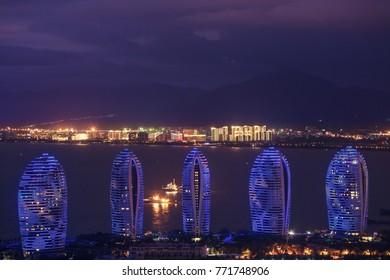 "Sanya, Hainan island, China - june 11, 2017. Panorama of night city, sea and buildings of hotels ""Phoenix Island Resort Sanya"""