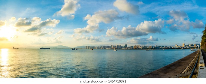 Sanya town evening cityscape, view from Phoenix island on Hainan Island in China