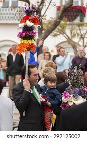 SAO BRAS DE ALPORTEL, PORTUGAL - April, 2015: Traditional religious procession of the flower torches event located in village of Sao Bras de Alportel, Portugal.