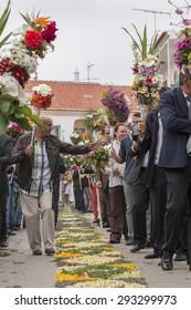 SAO BRAS DE ALPORTEL, PORTUGAL - April 5th, 2015: Traditional religious procession of the flower torches event located in village of Sao Bras de Alportel, Portugal.