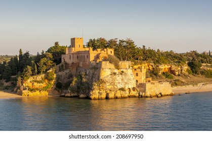Sao Joao do Arade Castle. A medieval fortress, located at the mouth of the Arade River, the Castle of Arade (Sao Joao do Arade) in Portimao, Algarve, Portugal features multi-tiered battlements.