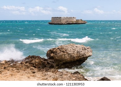 Sao Lourenco Blockhouse. San Lorenzo Island and fort nearby rocky shore and coastline of Mozambique island, Indian ocean coast. Portuguese East Africa. Fortim de São Lourenço da Ilha de Moçambique