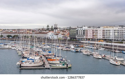 SAO MIGUEL, AZORES, PORTUGAL - OCTOBER 14, 2018: City view on the old town with harbor at Ponta Delgada, capital city of the Azores at Sao Miguel Island. Beautiful old town by the ocean