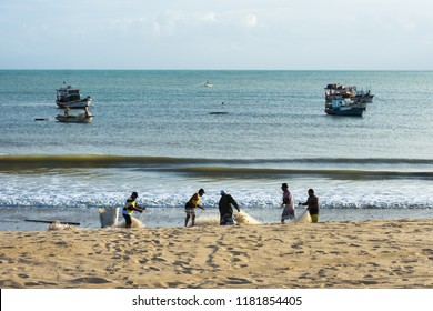 Sao Miguel do Gostoso, Rio Grande do Norte/Brazil - 06-21-2018: Silhouette of fishermen doing artisanal fishing early morning