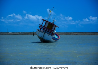 Sao Miguel dos Milagres / Brazil - December 8 2018: Fishing boat and beautiful landscape Sao Miguel dos Milagres, Alagoas, Brazil.
