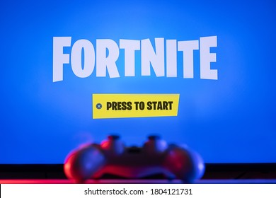 Sao Paulo, Brazil - 27/8/2020: Fortnite game runs on TV with Playstation 4 controller - Selective Focus