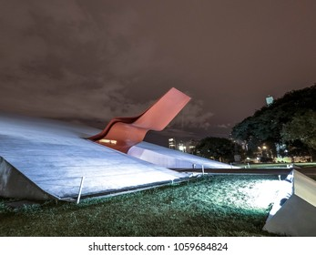 Sao Paulo, Brazil. April 01, 2018: Night view of facade of the Ibirapuera Auditorium (Portuguese: Auditorio Ibirapuera) is a building conceived by Oscar Niemeyer, situated in Ibirapuera Park