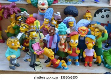 Sao Paulo / Brazil - April 27 2019: Closeup of The Simpsons cartoon old toys for sale in a flea market located in Sao Paulo, Brazil.