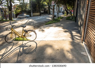 Sao Paulo, Brazil, April 27, 2019. Yellow OFO bicycle on street. From Chinese bike sharing company parked in Sao Paulo ready for hire by user of smartphone app.