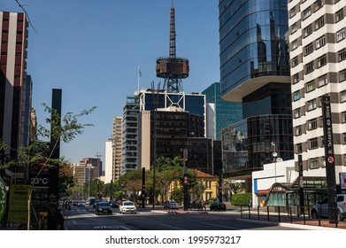 SAO PAULO - BRAZIL: AUG 12, 2020: Itau Cultural building with his iconic communication tower on top surrounded by many commercial buildings and office complexes at Paulista Avenue, Bela Vista district