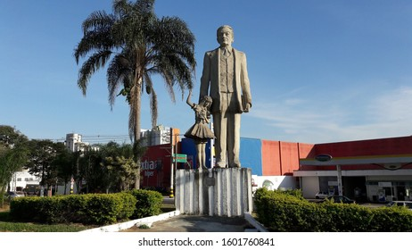 Taubaté, Sao Paulo, Brazil - August 7, 2016 - Statue of writer Monteiro Lobato holding the hand of Emilia, character of his stories, at the entrance of the city of Taubate.
