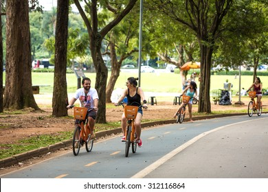 SAO PAULO, BRAZIL - CIRCA JAN 2015: People enjoy a hot day in Ibirapuera Park in Sao Paulo, Brazil.