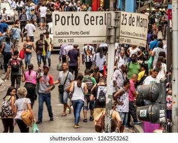 Sao Paulo, Brazil, December 11, 2018. Consumers in 25 de Marco Street conner Porto Geral street in Sao Paulo