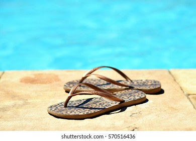 SAO PAULO, BRAZIL - DECEMBER 12th, 2016: Havaianas sandals (flip flops) in front of a pool