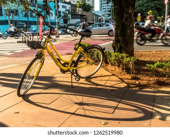 Sao Paulo, Brazil, December 14, 2018. Yellow OFO bicycle in the Brigadeiro Faria Lima Avenue. From Chinese bike sharing company parked in Sao Paulo ready for hire by user of smartphone app.
