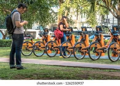 Sao Paulo, Brazil, December 14, 2018. users access the APP for Urban bikes for hire in Tembici Station of Bike in Faria Lima Avenue, in Sao Paulo city, Brazil