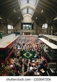 Sao Paulo, Brazil - December 19th, 2019: Municipal market in Sao Paulo downtown. Brazilian flag on city market. Traditional Market in Brazil.