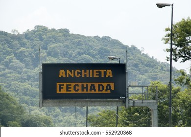 Sao Paulo, Brazil - December, 19th 2016: A road that connects Sao Paulo to South Coast, next to the beach of Santos, Guaruja and Bertioga Cities. Signs in Portuguese that means Anchieta road closed.