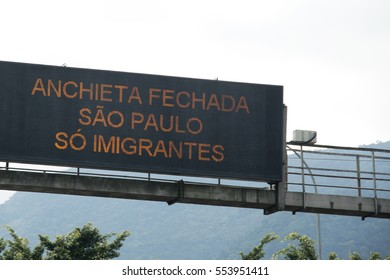Sao Paulo, Brazil - December, 19th 2016: A road that connects Sao Paulo to South Coast, next to the beach of Santos, Guaruja and Bertioga Cities. Signs in Portuguese that means Anchieta road closed