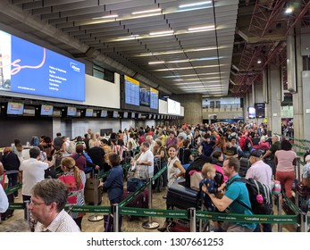 Sao Paulo, Brazil - December 2, 2018: Passengers wait in line to check in with Gol at Sao Paulo International Airport