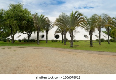 "Sao Paulo, Brazil, december 2018. The ""Oca"" seen from the exterior. It is a museum located in Ibirapuera park and designed by Oscar Niemeyer"