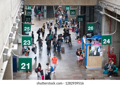 SAO PAULO, SAO PAULO, BRAZIL - December 25, 2018: People rush or wait for their bus in Tiete, the largest and most famous bus station in Latin America.