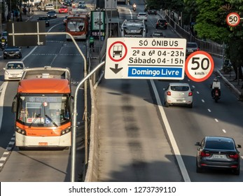 Sao Paulo, Brazil, December 28, 2018. Bus traffic and street sign in the exclusive bus corridor of Reboucas Avenue, west of Sao Paulo