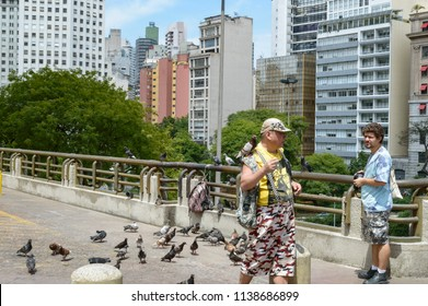 Sao Paulo, Sao Paulo, Brazil, December 3, 2016, Dove man and a photografer trying to take a picture of him, Sao Paulo Downtown