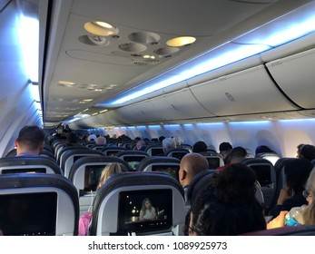SAO PAULO, BRAZIL - FEB 22, 2018: Airplane Interior  view all seats from back of plane.