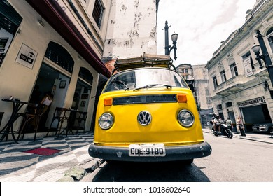 SAO PAULO, BRAZIL - FEBRUARY 02: Horizontal picture of yellow Kombi, a german car, parked in the street of Sao Paulo, Brazil.
