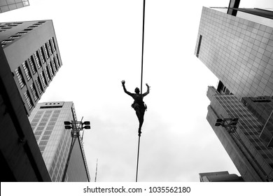 Sao Paulo, Brazil. February 25, 2018. The slackliner, Leandro, usually practices every Sunday at Avenida Paulista, in Sao Paulo.