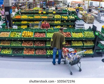 Sao Paulo, Brazil ,, February 27, 2018. people choose fruits and vegetables in a supermarket