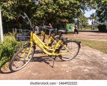 Sao Paulo, Brazil, January 09 14, 2019. Yellow OFO bicycle in front of entrance of Parque do Povo, People Park. From Chinese bike sharing company parked in Sao Paulo ready for hire by user of app.