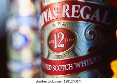 SAO PAULO, BRAZIL - JANUARY, 2019: Close-up in a bottle of Chivas Regal 12yo, with Chivas 18yo at the blurred background.