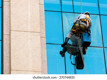 Sao Paulo, Brazil, January 31, 2015. Worker cleaning windows of a commercial building on January 31, 2015 in Sao Paulo, Brazil.