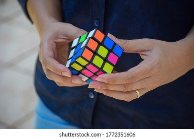 Sao Paulo, Brazil - January 7, 2020: Rubik's cube in hand trying to solve - a symbol of business, ideas, solutions.