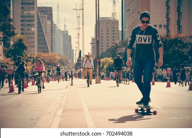 SAO PAULO, SAO PAULO - BRAZIL - JUL 30, 2017: Avenida Paulista in Brazil closed for leisure with various people walking practicing sports