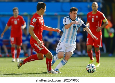 SAO PAULO, BRAZIL - July 1, 2014: Lionel Messi of Argentina and Fabian Schaer of Switzerland compete for the ball during the World Cup Round of 16 at Arena Corinthians. No Use in Brazil.
