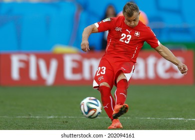 SAO PAULO, BRAZIL - July 1, 2014: Xherdan Shaqiri of Switzerland kicks the ball during the 2014 World Cup Round of 16 game between Argentina and Switzerland at Arena Corinthians. No Use in Brazil.