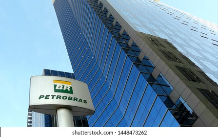 Sao Paulo / Brazil - July 11 2019: Lettering and logo of Petrobras in front of its an office building at Avenida Paulista.