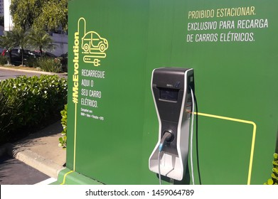 Sao Paulo / Brazil - July 22 2019: McEvolution, a station for recharging electric cars at McDonald's, fast food company, parking lot. Compatible with BMW, Volvo, Porsche, BYD.