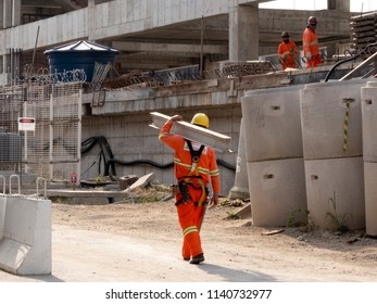 Sao Paulo, Brazil, July 23, 2018: Workers in the construction of the elevated metro track, Line 17 gold, on Roberto Marinho Avenue, in Sao Paulo. Brazil. This work is years behind schedule.