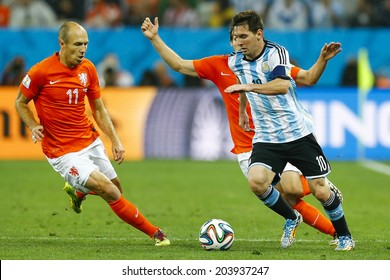 SAO PAULO, BRAZIL - July 9, 2014: Messi of Argentina and Robben of Netherlands compete for the ball during the game between Netherlands and Argentina at Arena Corinthians. NO USE IN BRAZIL.