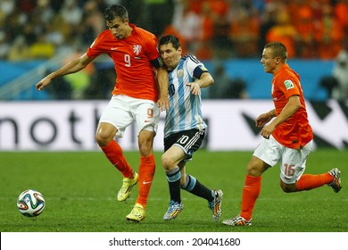 SAO PAULO, BRAZIL - July 9, 2014: Lionel Messi and Robin Van Persie during the 2014 World Cup Semi-finals game between the Netherlands and Argentina at Arena Corinthians. NO USE IN BRAZIL.