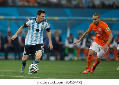 SAO PAULO, BRAZIL - July 9, 2014: Lionel Messi and Wesley Sneijder during the World Cup Semi-finals game between Netherlands and Argentina at Arena Corinthians