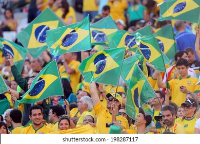 SAO PAULO, BRAZIL - June 12, 2014: Fans waving Brazilian flags during the World Cup Group A opening game between Brazil and Croatia at Corinthians Arena. No Use in Brazil.