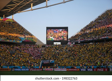 SAO PAULO, BRAZIL - June 12, 2014: Brazilian fans during the World Cup Group A opening game between Brazil and Croatia at Corinthians Arena. No Use in Brazil.
