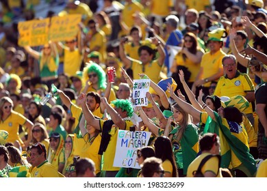 SAO PAULO, BRAZIL - June 12, 2014: Brazilian fans during the opening ceremony of the FIFA 2014 World Cup at Corinthians Arena. No Use in Brazil.