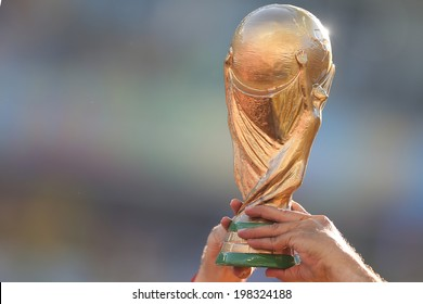SAO PAULO, BRAZIL - June 12, 2014: A replica of the World Cup being showcased during the World Cup Group A opening game between Brazil and Croatia at Corinthians Arena. No Use in Brazil.