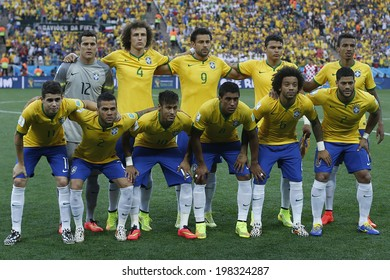 SAO PAULO, BRAZIL - June 12, 2014: Brazil team posing for a photo during the FIFA 2014 World Cup opening game. Brazil is facing Croatia in the Group A at Corinthians Arena. No Use in Brazil.